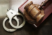 Handcuffs and gavel for homicide crime